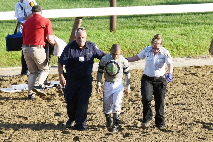 Jockey Javier Castellano walks off the track after he fell off his mount, Fight Night, in the 10th race Friday.