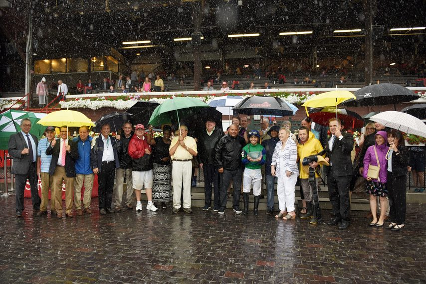 Dozens of Rick Violette's friends weather the rain after the second race at Saratoga, named in his honor.