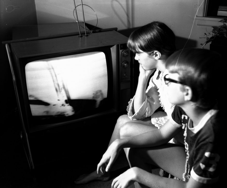 Patty and Marc Schultz, 14, of Rotterdam, watch astronaut Neil Armstrong on the moon on Sunday, July 20, 1969.