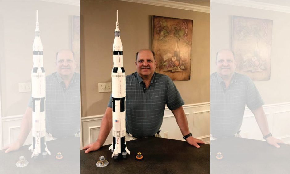 Michael Davi of Niskayuna with a rocket model of the Saturn V launch system he built in honor of the Apollo 11 moon mission.