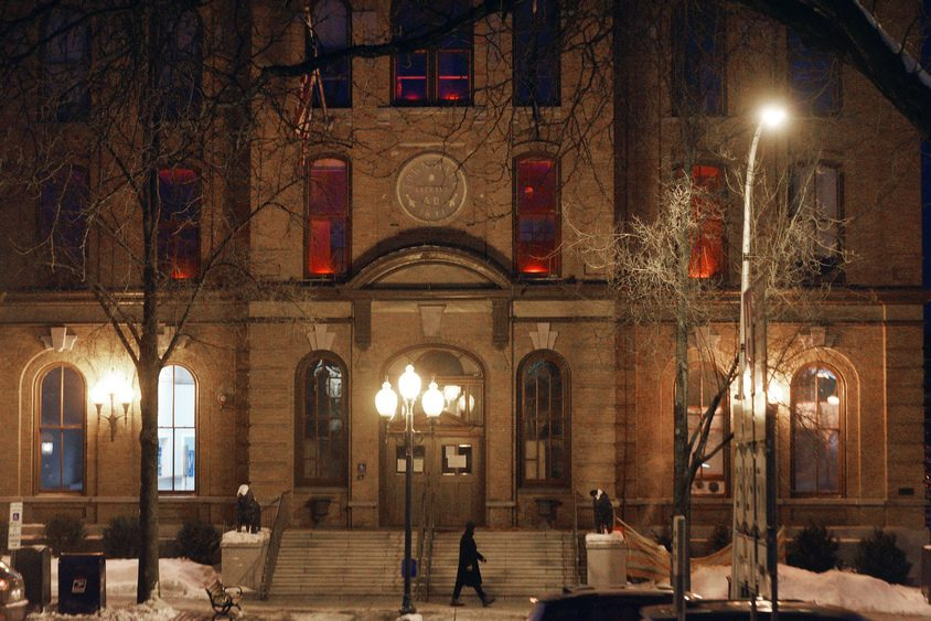 The Saratoga Springs City Hall entrance is lit up red after the American Heart Assocation's Saratoga Glows Red event on Jan. 31.