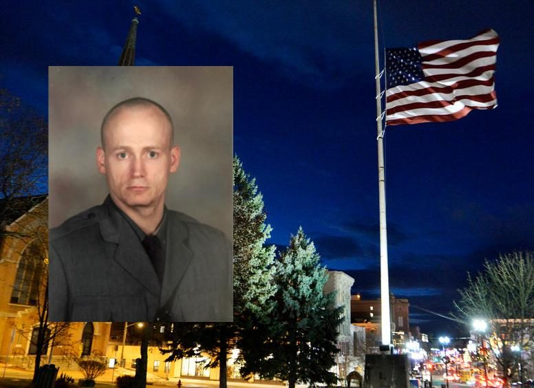 Trooper Jeremy J. VanNostrand (inset); A flag in Schenectady flies at half staff in his honor after his death.