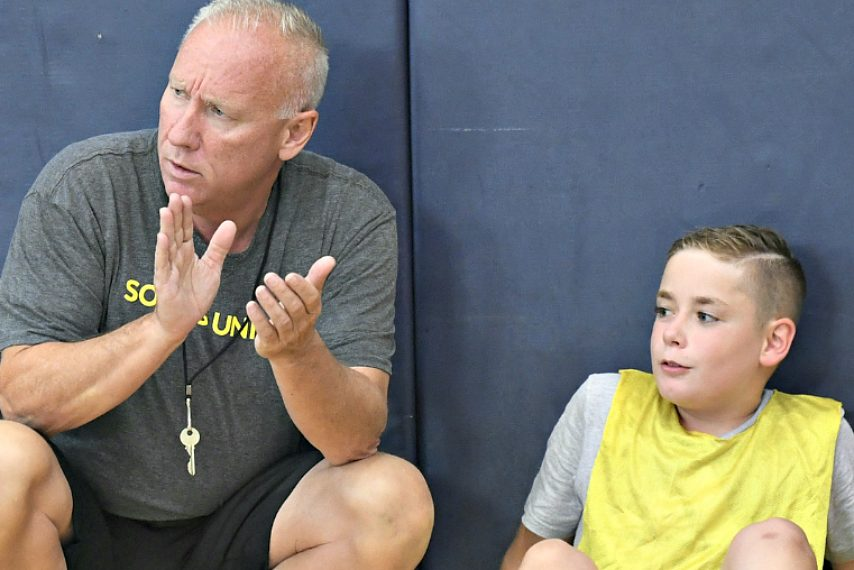 Brian Beaury, left, is shown with camper William Reutzel at Wednesday's camp.