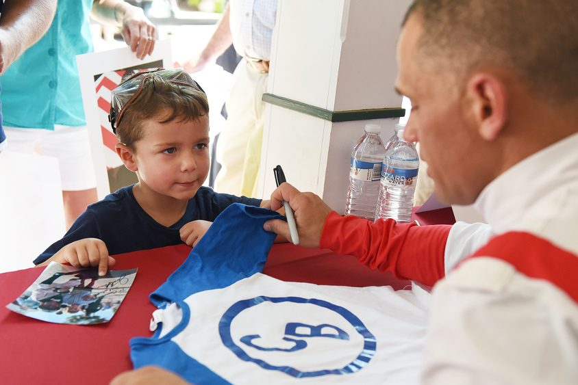 Christopher Buda, 4, of Clifton Park, watches as Javier Castellano signs his shirt during an autograph session Saturday.