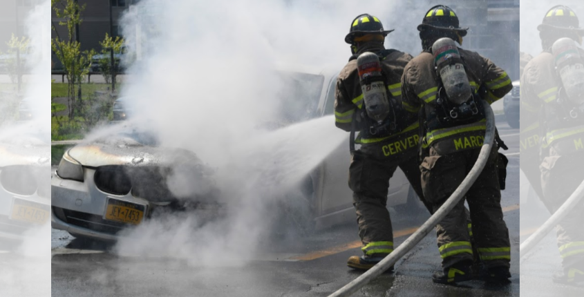 Schenectady firefighters Dylan Cervera and Matthew March put out a car fire Tuesday