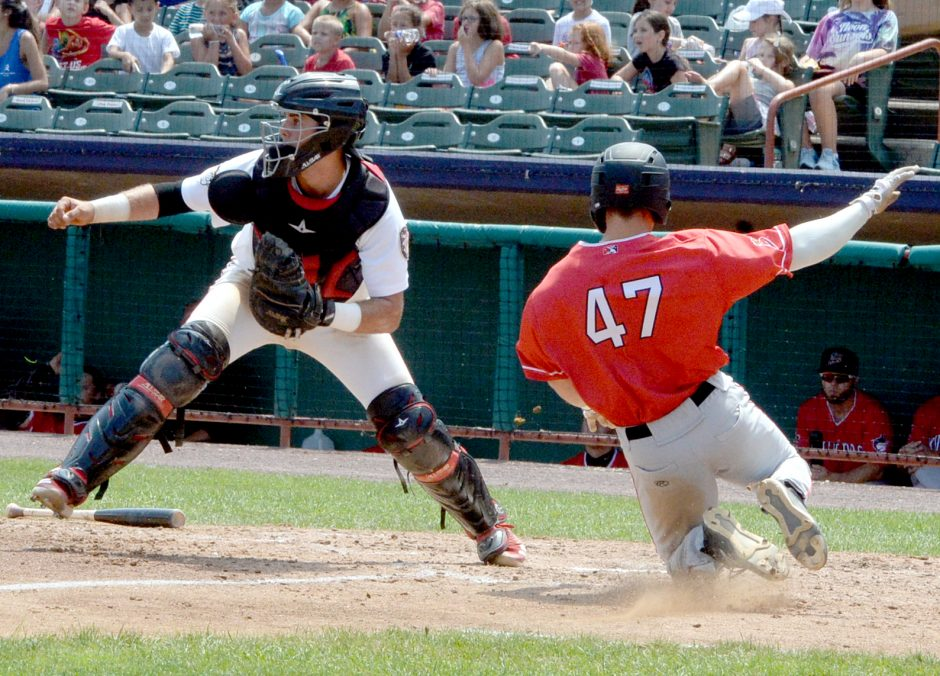 Batavia's Jack Strunc scores as Tri-City catcher waits for the throw in the fifth inning Thursday.