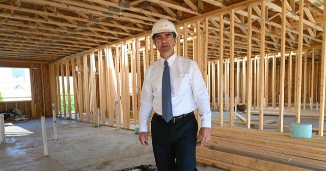 Mike Saccocio, executive director and CEO of the Schenectady City Mission, leads a tour of its new transitional housing units.