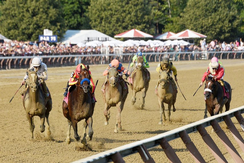 McKinzie, second from left, wins the Whitney by 1 3/4 lengths over Yoshida, left, on Saturday.