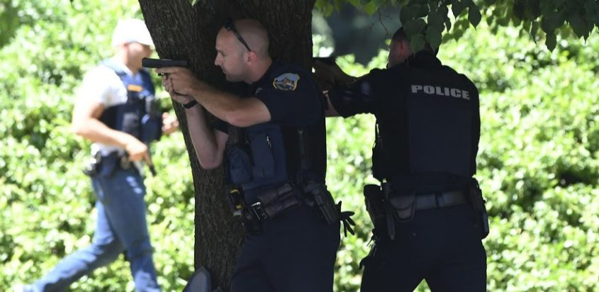 Police officers take up positions outside the Union Street residence July 1