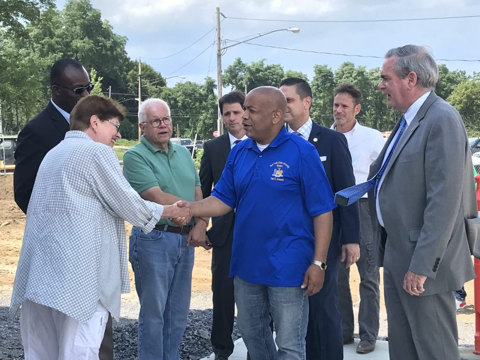 Assembly Speaker Carl Heastie greets county Legislator Peggy King on Thursday at the future site of the Boys & Girls Club.