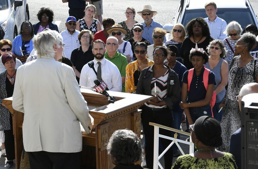 Rev. Phil Grigsby speaks at a prayer vigil in remembrance of the victims in El Paso and Dayton in Schenectady.