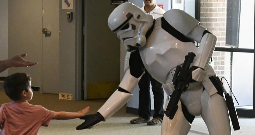 James Roberts, 4, of West Sand Lake greets a storm trooper at the Schenectady Museum of Innovation and Science on Saturday.