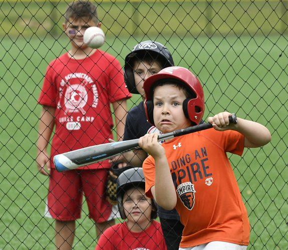 Cole Trumble, 6, of Schenectady makes a bunt at the Oldtimers Baseball Camp in Central Park Tuesday.