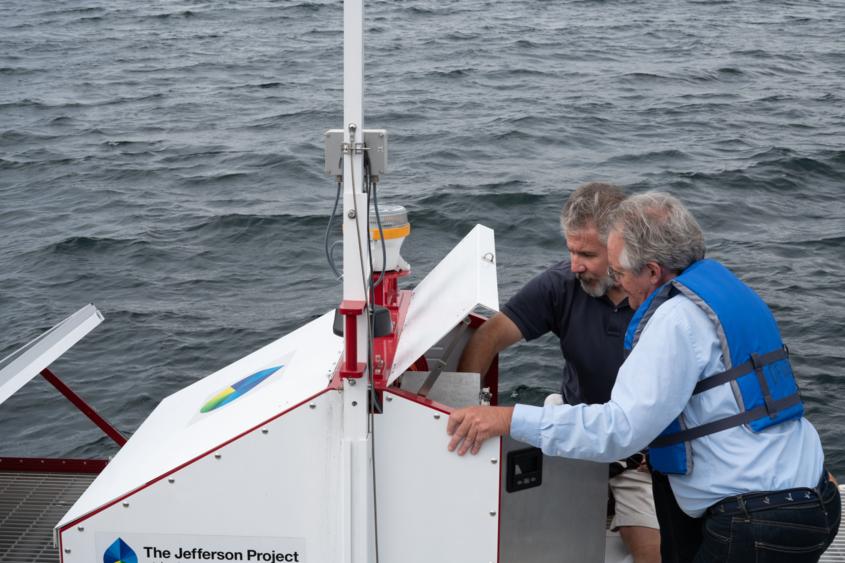 IBM Jefferson Project scientist Mike Kelly, left, explains a mid-lake sensor platform to Stephen Williams.