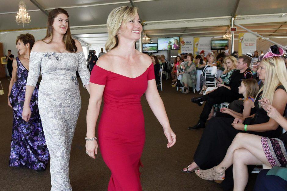 Women model fashions at a past Saratoga Fashion Show.