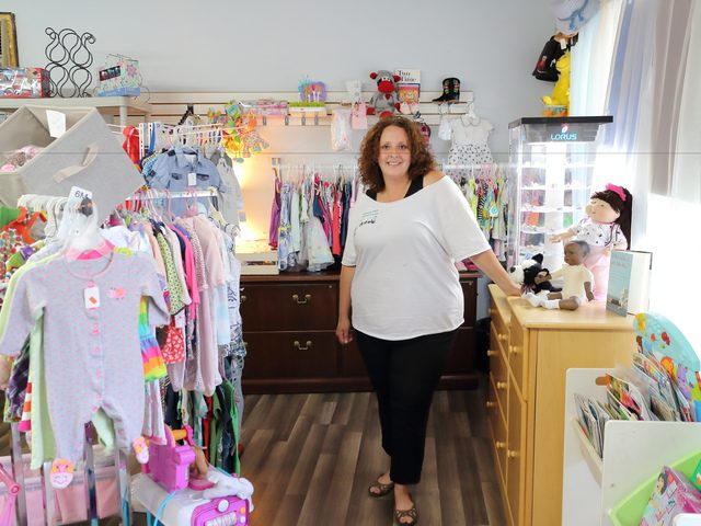 Kristine Moore is shown in her store, Goose Hill Good Finds, on Thursday.