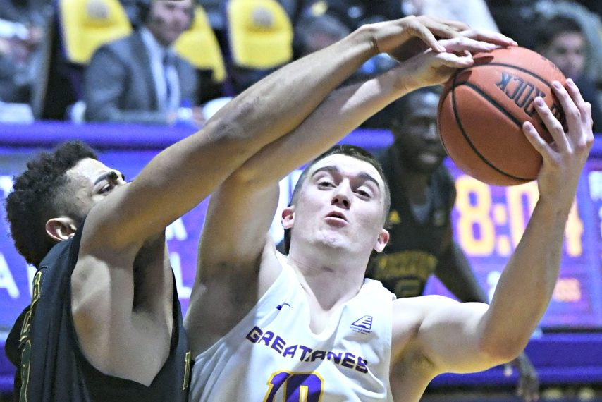Cameron Healy, right, makes a pass during a UAlbany game last season.