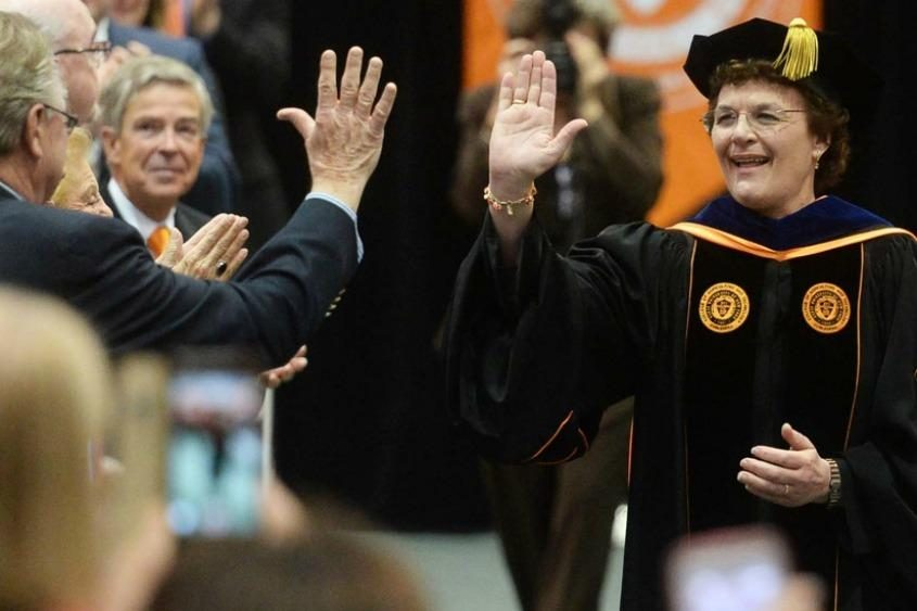 SUNY Cobleskill President Marion Terenzio gives a high-five during graduation ceremonies in 2016.