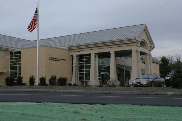 The main entrance of the Clifton Park-Halfmoon Library is shown.