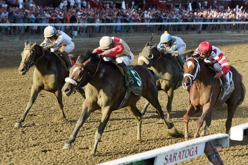 Preservationist (5) gets to the wire before Yoshida, left, and Bal Harbour, right, to win the Woodward.