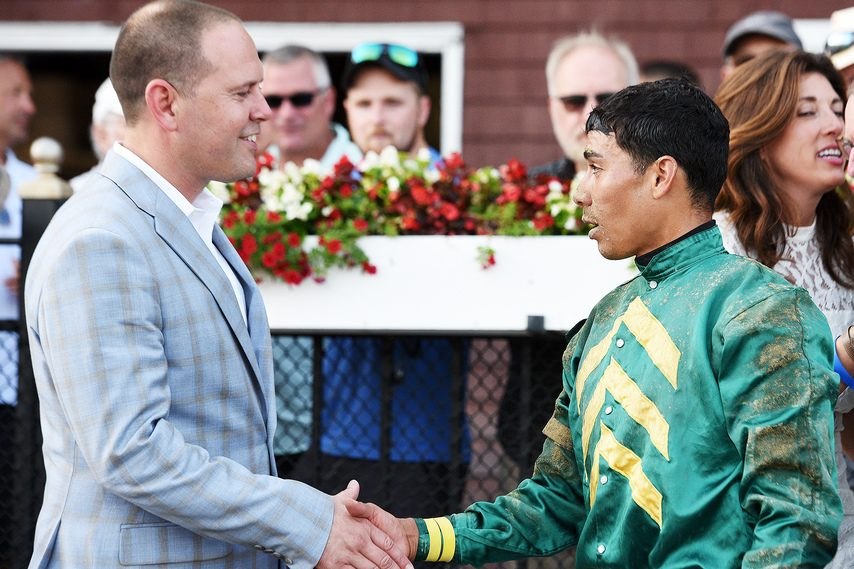 Trainer Chad Brown, left, and jockey Jose Ortiz shake hands after teaming up to win the Curlin with Highest Honors on July 13.