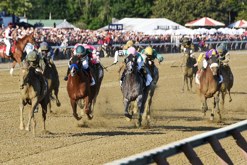 Code of Honor, left, wins the Travers on Aug. 24, when Saratoga generated a record $52,129,344 in all-sources betting handle.
