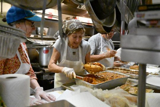 Bette Kraut makes brisket sandwiches in Congregation Augdat Achim's kitchen Sunday afternoon for the Carrot Festival.
