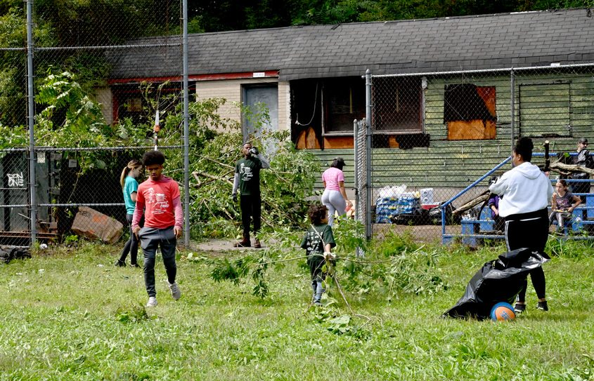 Volunteers help with Sunday's cleanup of the old Bellevue Little League field.