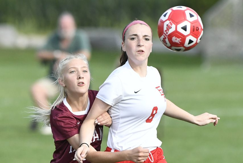 Scotia-Glenville's Sage Luke, left, and Broadalbin-Perth's Emily Bush chase a loose ball in the Tartans' 10-0 victory.
