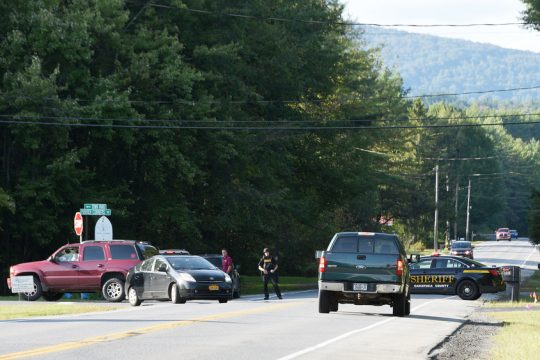 Troopers and deputies block Route 9N in Greenfield on Thursday, Sept. 12, 2019, during the search of a man carrying a gun.