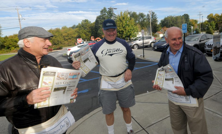 Nick Barber, Jeff Wilkin and Mark Quant sell papers in Rotterdam during the Daily Gazette Old Newsboys Day.