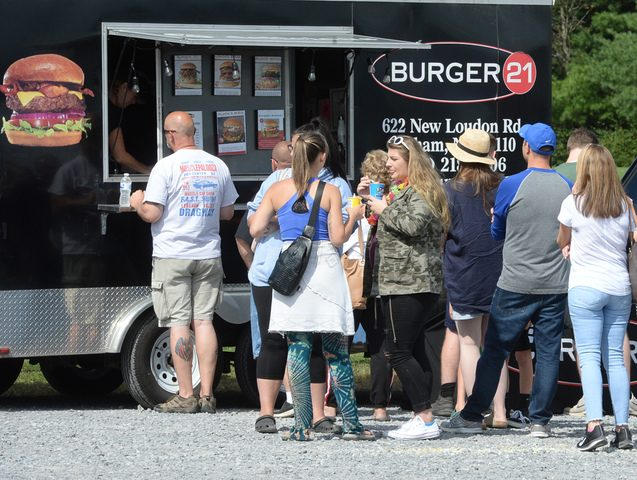 Patrons line up to purchase food from the Burger 21 truck during the Second Annual Niskayuna Food Truck Festival on Sunday.