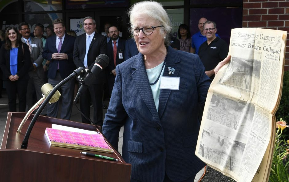 Chairwoman Betsie Hume Lind speaks in front of the Daily Gazette building at the Image 360 Grand Opening, July 20, 2019.