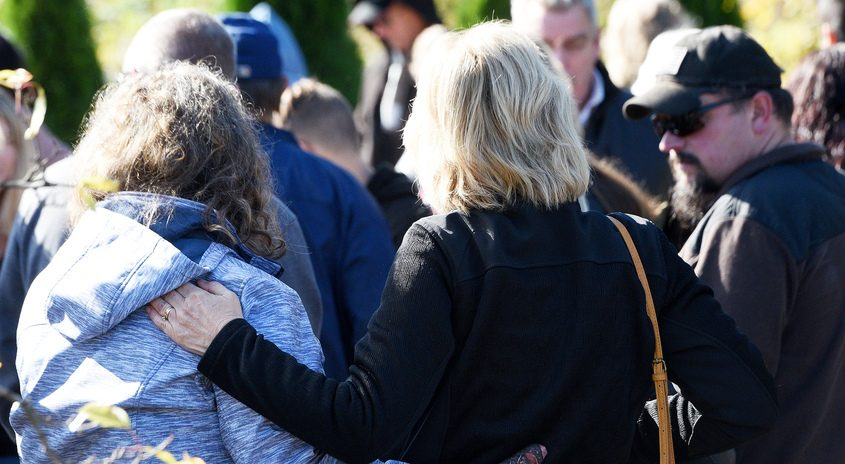 Friends and family console each other during the Reflections Memorial Foundation Commemorative Service