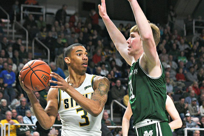 Siena's Manny Camper, left, is shown during a game last season.