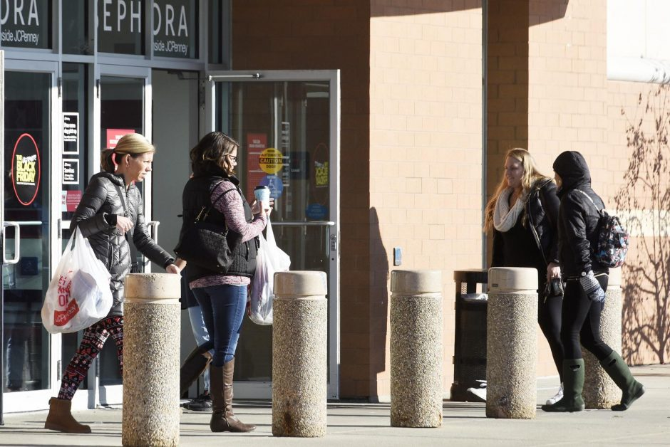 Customers stand outside the Wilton Mall last November.