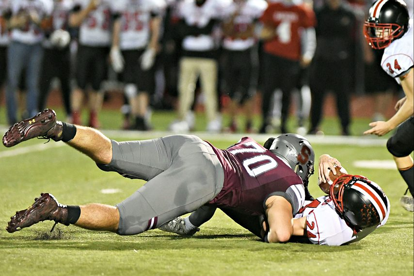 Stillwater's Brian McNeil makes a tackle during a Week 6 game.