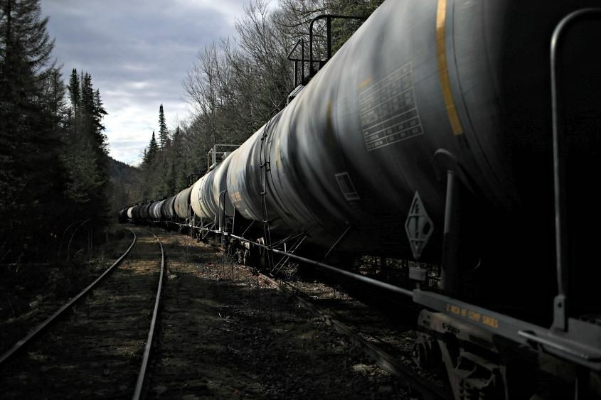 Oil tank cars sit on tracks on a rail line the state wants to turn into a recreational trail.