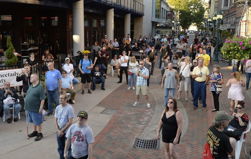 Visitors enjoy live music on Jay Street in downtown Schenectady.