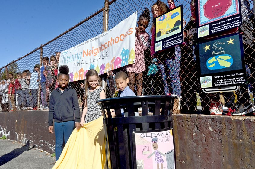 The artwork of Yates students, from left, Zonilay McClinton, Carson F. and Jeremiyah Thompson appears on a trash can.