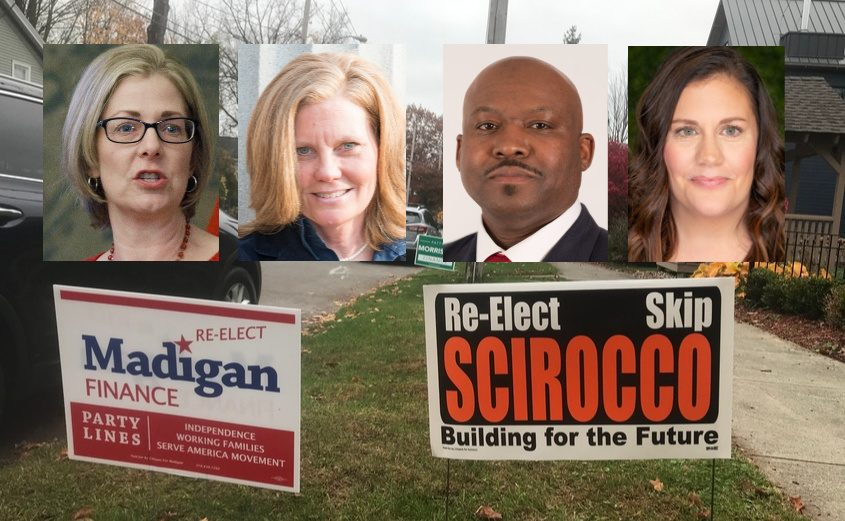 From Left: Madigan, Morrison, Hicks and Dalton; Background: Political signs in Saratoga Springs