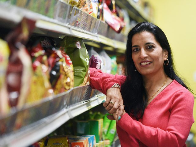 Gurbax Kaur, owner of Guru's Supermarket in Clifton Park, poses for a photo inside her store.