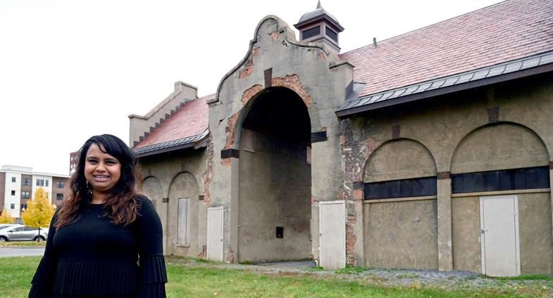 Aneesa Waheed of Tara Kitchen stands in front of the old Weigh Station on Broadway in Schenectady.