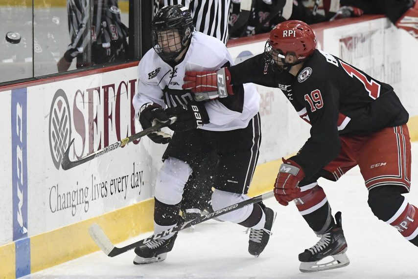 Union's Brandon Estes clears the puck while under pressure from RPI's Ture Linden at Houston Field House on Oct. 26.