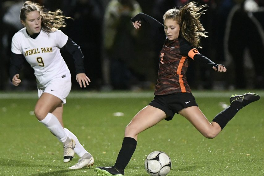 Liv Raucci of Mohonasen is defended by Averill Park's Elizabeth Owens in the Class A soccer final.
