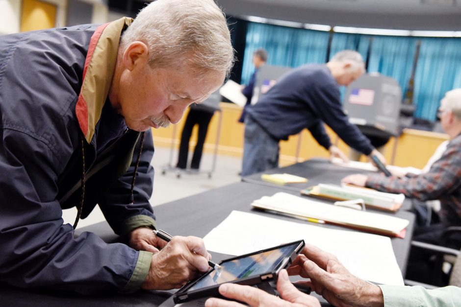 Dan Perrin, of Niskayuna, signs in during the first early elections at Niskayuna Town Hall on Saturday, October 26, 2019.