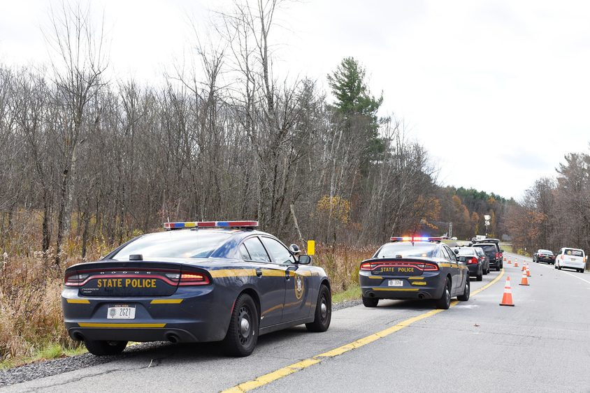 State police cruisers are parked at the Northway Exit 13S southbound ramp in Malta on Friday.