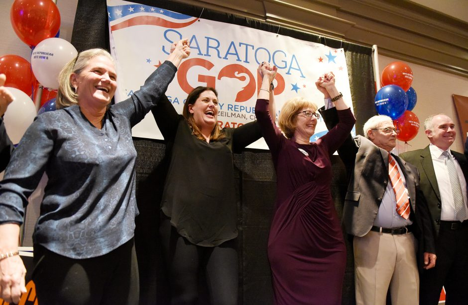 Meg Kelly, Robin Dalton, Michele Madigan, Skip Scirocco, and Matt Veitch declare victory in Saratoga Springs on Tuesday.