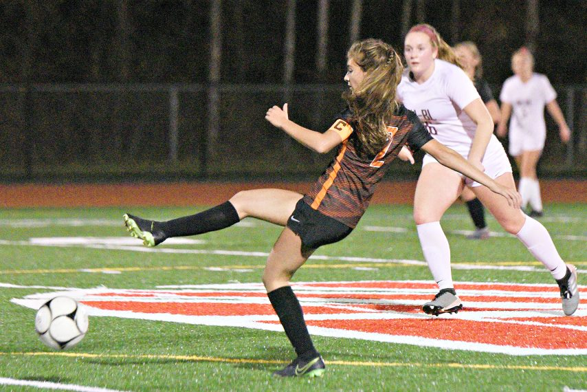 The Mohonasen girls' soccer team, shown in action against Burnt Hills last week, has advanced to the Class A regionals.