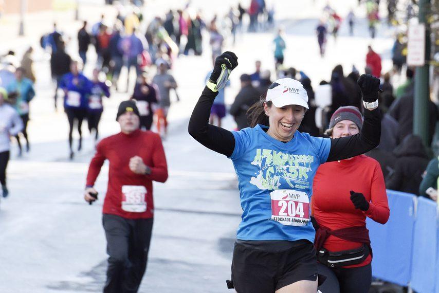 Runners finish the 2018 Stockade-athon on Franklin Street next to City Hall.